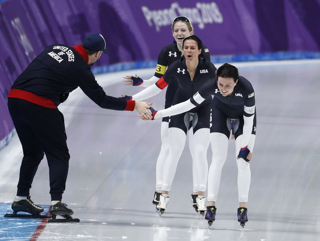 Team U.S.A. with Heather Bergsma, front, Brittany Bowe, center, and Mia Manganello, rear, celebrates with their coach after the quarterfinals of the women's team pursuit speedskating race at the Gangneung Oval at the 2018 Winter Olympics in Gangneung, South Korea, Monday, February 19, 2018. (Photo by John Locher/AP Photo)