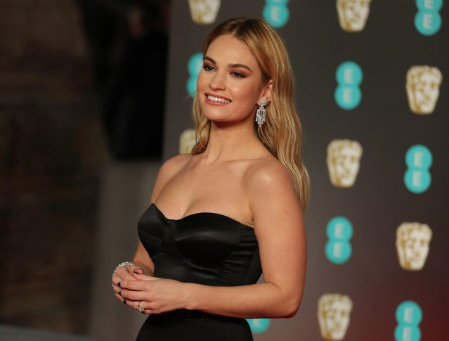 British actress Lily James poses on the red carpet upon arrival at the BAFTA British Academy Film Awards at the Royal Albert Hall in London on February 18, 2018. (Photo by Daniel Leal-Olivas/AFP Photo)