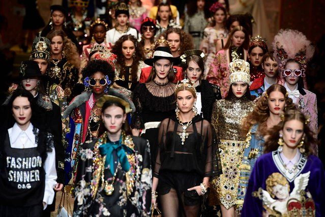 Models present creations by Dolce & Gabbana during the women's Fall/Winter 2018/2019 collection fashion show in Milan, on February 25, 2018. (Photo by Miguel Medina/AFP Photo)