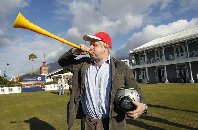 London Mayor Boris Johnson blows a vuvuzela during his visit to Waterfront in Cape Town, June 16, 2010. (Photo by Oleg Popov/Reuters)