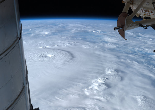 Typhoon Bopha moves toward the Philippines, observed from the ISS, on December 2, 2012. (Photo by AP Photo/NASA/The Atlantic)