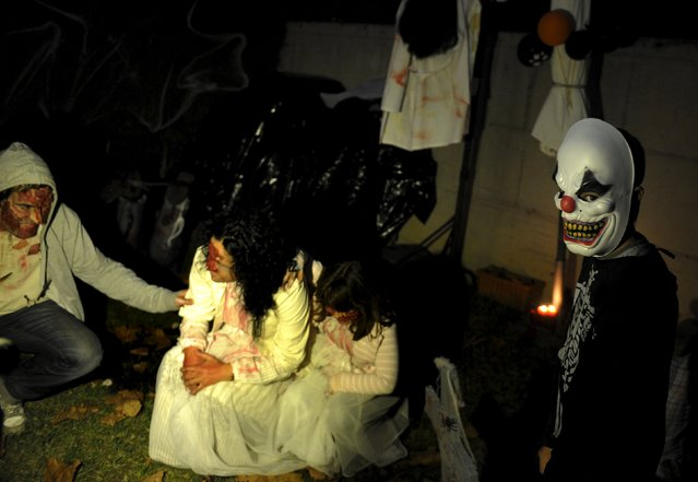 Children take part in Halloween celebrations in La Fresneda, northern Spain, October 31, 2015. (Photo by Eloy Alonso/Reuters)