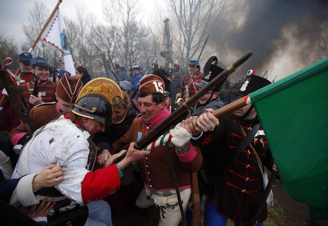 People dressed as Hungarian Hussars, or cavalrymen, and Austrian soldiers of the Habsburg dynasty take part in the re-enactment of the battle of Tapiobicske, 80 km (50 miles) southeast of Budapest April 4, 2013. The battle was fought some 164 years ago on April 4. (Photo by Laszlo Balogh/Reuters)