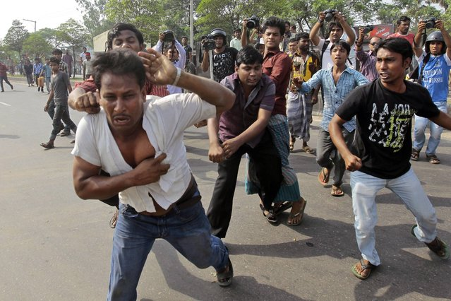 Bangladeshi activists of Hifazat-e-Islam beat a man who is alleged to have helped the police to identify the protesters during a strike in Dhaka, Bangladesh, Monday, April 8, 2013. At least 20 people were injured in southwestern Bangladesh as a hardline Islamic group enforces a general strike to back its demands for an anti-blasphemy law. (Photo by A. M. Ahad/AP Photo)