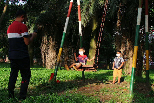 Children wearing facemasks seen playing at Ramna park during Coronavirus pandemic. After a six-month-long hiatus due to coronavirus pandemic, Ramna Park has reopened for the public. (Photo by Sultan Mahmud Mukut/SOPA Images/Rex Features/Shutterstock)