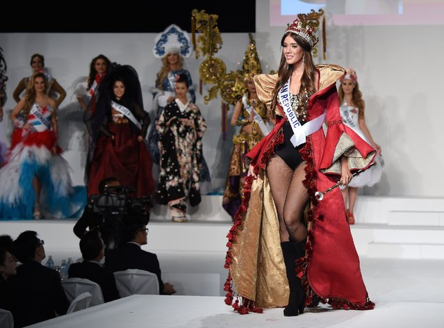 Miss Dominican Republic Irina Peguero (R) displays her national costume during the Miss International beauty pageant in Tokyo on November 5, 2015. (Photo by Toru Yamanaka/AFP Photo)