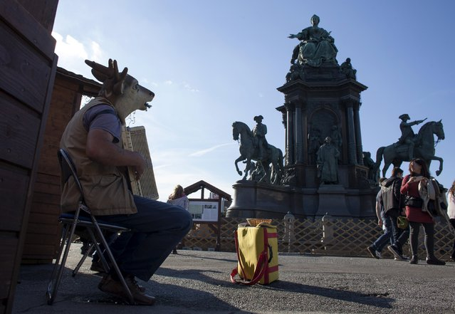 A street musician with his face covered with an animal mask plays to earn some money in central Vienna, Austria, November 8, 2015. (Photo by Vasily Fedosenko/Reuters)