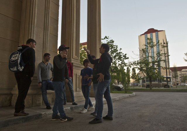 A group of young Chechen men hang out on a street corner in the centre of the Chechen capital Grozny April 29, 2013. (Photo by Maxim Shemetov/Reuters)