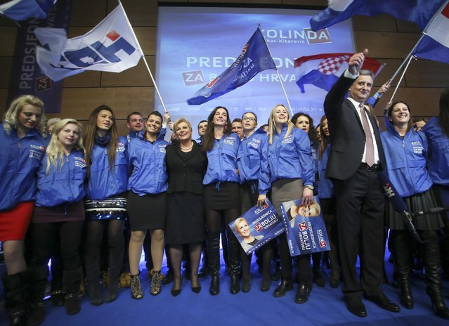 Presidential candidate of Croatian Democratic Union (HDZ) party Kolinda Grabar-Kitarovic (5th L) and president of HDZ Tomislav Karamarko (2nd R) celebrate with her supporters after unofficial results in Zagreb December 28, 2014. Ivo Josipovic faces a tight run-off next month to try to win a second five-year term as Croatia's president after failing to secure a majority from voters frustrated by the country's economic malaise. (Photo by Reuters/Stringer)