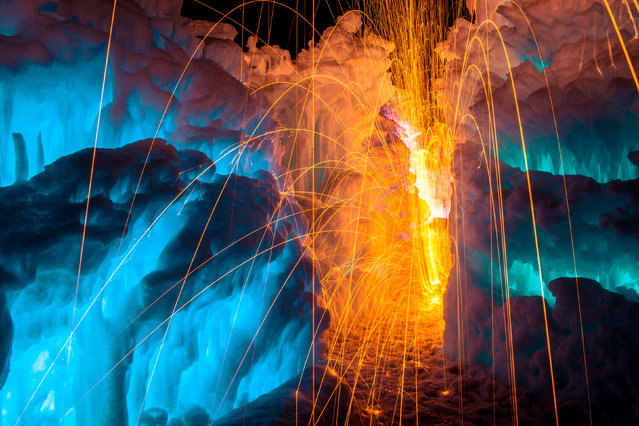 Fire in the ice castle. (Photo by Sam Scholes/Caters News)