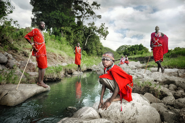 """""""One Day a Masai Warrior"""". These Masai tribes people live in the wilderness of Kenya and still uphold most of their traditional values and customs. The colour red is worn to represent power, and accessories and body ornaments are be worn to reflect their identity and status in society. Traditionally, a Masai boy would only become a Masai warrior after he went out on his own and killed a lion, as a rite of passage. Location: Masai Mara, Kenya. (Photo and caption by David Lazar/National Geographic Traveler Photo Contest)"""