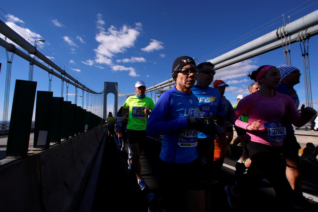 Runners cross the Verrazano–Narrows Bridge during the 2016 New York City Marathon in the Manhattan borough of New York City, NY, U.S. November 6, 2016. (Photo by Brendan McDermid/Reuters)