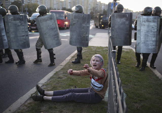 A woman reacts in front of police line during a rally in Minsk, Belarus, Wednesday, September 23, 2020. (Photo by TUT.by via AP Photo)