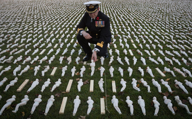 Jake Moores, who was a Commodore in the Royal Navy looks at some of the 19,420 figurines that have been laid out on College Green as part of the 19240 Shrouds of the Somme art installation on November 11, 2016 in Bristol, England. A memorial service will be held later today besides the artwork by artist Rob Heard, which features 19,240 figurines representing each one of the British soldiers who died on the first day of the Battle of the Somme. Today, people across the UK and the world will gather to pay tribute to service personnel who have died during conflicts, as part of the annual Remembrance ceremonies marking Armistice Day on the 11th hour of the 11th day of the 11th month. (Photo by Matt Cardy/Getty Images)