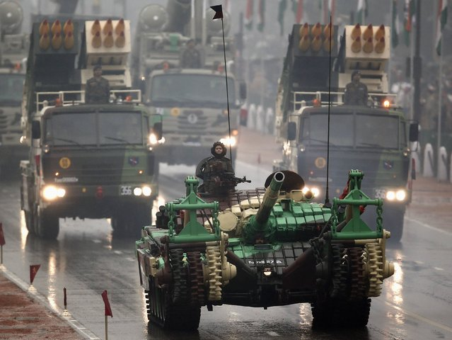 An Indian army tank and multiple launch rocket systems roll down the street as part of the Republic Day parade in New Delhi January 26, 2015. (Photo by Ahmad Masood/Reuters)