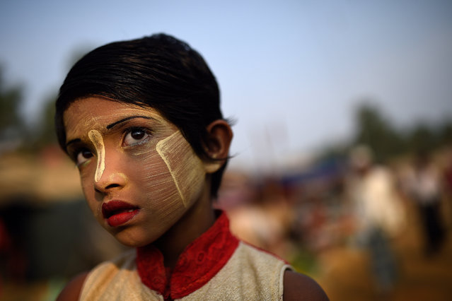 A Rohingya refugee girl named Rufia Begum, aged 9, poses for a photograph as she wears thanaka paste at Balukhali camp in Cox's Bazaar, Bangladesh, March 31, 2018. (Photo by Clodagh Kilcoyne/Reuters)