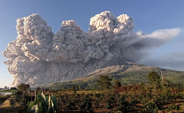 Mount Sinabung spews some 5,000-metre-high of hot ash into the sky seen from Karo, North Sumatra on March 2, 2021. (Photo by Sastrawan Ginting/AFP Photo)