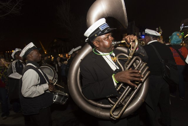A member of a brass band plays in the Krewe du Vieux 2015 parade, the first parade of the Mardi Gras festivities, through the French Quarter in New Orleans January 31, 2015. (Photo by Lee Celano/Reuters)