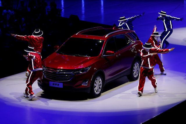 Dancers perform in front of the next-generation Equinox SUV shown at a Chevrolet event in Guangzhou, China November 17, 2016. (Photo by Bobby Yip/Reuters)