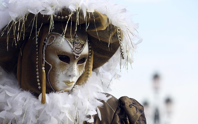 A masked reveller poses in St. Mark's square during the Carnival in Venice, February 7, 2015. (Photo by Stefano Rellandini/Reuters)