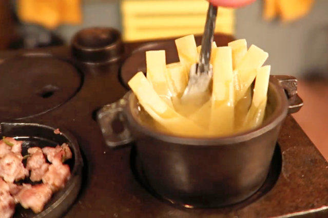 Jay puts the pasta on the stove to boil. (Photo by Jay Baron/Caters News)