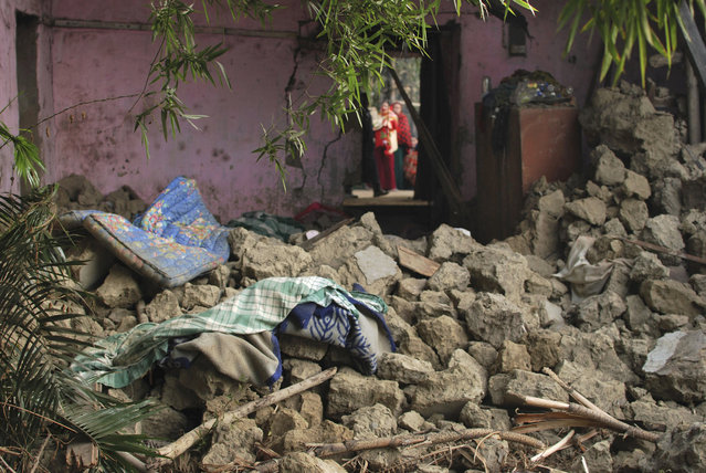 The interior of a house is damaged after an earthquake in Imphal, capital of the northeastern Indian state of Manipur, Monday, January 4, 2016. (Photo by Bullu Raj/AP Photo)