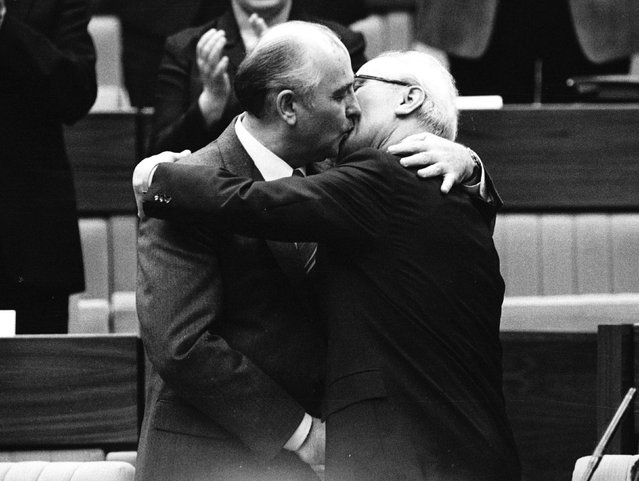 Soviet Leader Mikhail Gorbachev (L) congratulates East German Leader Erich Honecker with a kiss after Honecker's re-election as General Secretary of the Communist Party Congress in East Berlin in this April 21, 1986 file photo. (Photo by Reuters/Stringer)
