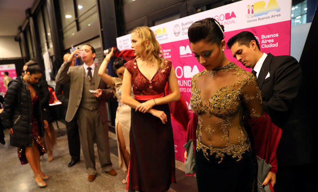 Dancers get ready backstage before the Stage style final round at the Tango World Championship in Buenos Aires, Argentina on August 23, 2018. (Photo by Marcos Brindicci/Reuters)