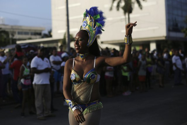 A reveler participates in the third day of the annual Carnival parade in Panama City February 16, 2015. (Photo by Carlos Jasso/Reuters)