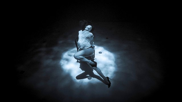 Spanish free-diver and dancer Ariadna Hafez performs a tango dance at a depth of 10 metres inside the Y-40 pool in Montegrotto Terme, Italy on April 13, 2021. (Photo by Bastien Soleil via Reuters)