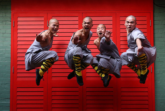 Shaolin monks pose for a photograph in Chinatown on February 23, 2015 in London, England. The monks practice Shaolin Kung Fu which is believed to be the oldest institutionalised style of kung fu and are demonstrating their skills while in the UK. (Photo by Carl Court/Getty Images)