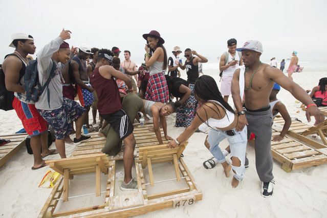 People gather to twerk during spring break festivities in Panama City Beach, Florida March 12, 2015. (Photo by Michael Spooneybarger/Reuters)