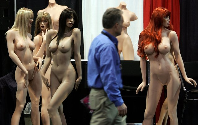 A man walks by a display of mannequins at the s*xy Mannequin booth during the 2007 AVN Adult Entertainment Expo at the Sands Convention Center January 10, 2007 in Las Vegas, Nevada. (Photo by Justin Sullivan/Getty Images)