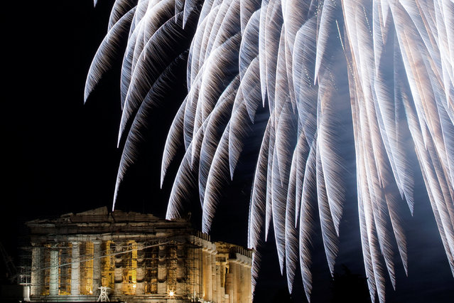 Fireworks explode over the ancient Parthenon temple atop Acropolis hill during New Year's day celebrations in Athens, Greece, January 1, 2017. (Photo by Alkis Konstantinidis/Reuters)