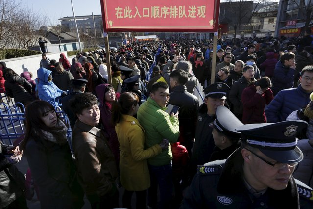 People wait in lines to enter Baiyun Temple to touch a statue of a stone monkey for good fortune on the first day of the Chinese Lunar New Year of the Monkey, in Beijing, China, February 8, 2016. Tens of thousands of worshippers visited the ancient Taoist temple in China's capital to commemorate the Year of the Monkey. (Photo by Jason Lee/Reuters)