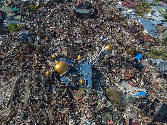 An aerial view of an area devastated by an earthquake and tsunami in Palu, Central Sulawesi, Indonesia, October 1, 2018. (Photo by Hafidz Mubarak A./Reuters/Antara Foto)