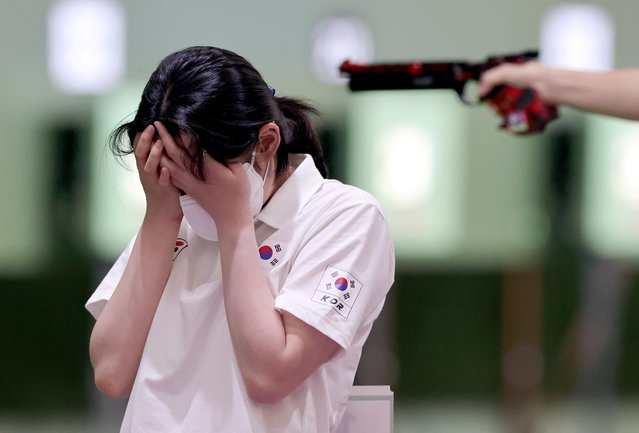 Choo Gaeun of South Korea reacts during competition with Jin Jongoh of South Korea during the mixed 10m air pistol team qualification during Tokyo 2020 Olympics at Asaka Shooting Range in Tokyo, Japan on July 27, 2021. (Photo by Ann Wang/Reuters)