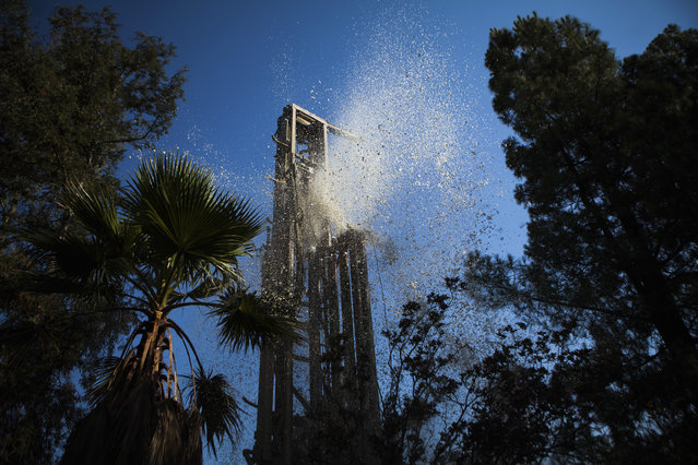 Water and mud blow out of the top of a drill, as Diamond Well Drillers drill to deepen the Brady family well in Woodland, August 20, 2014. (Photo by Max Whittaker/Reuters)