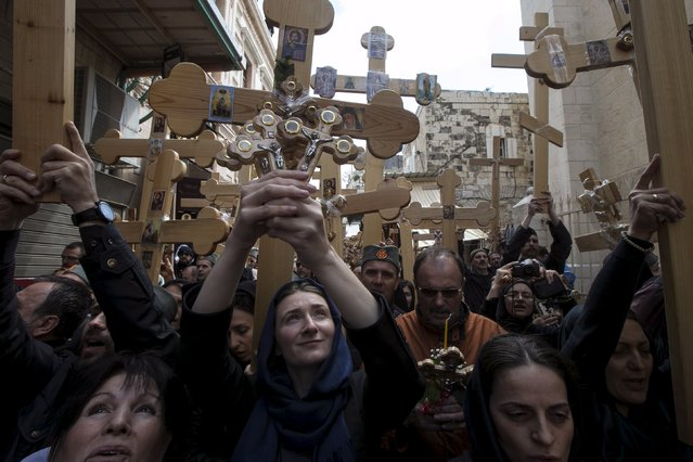 Orthodox Christian worshippers from Serbia hold crosses as they walk along Via Dolorosa during the Holy Week Good Friday procession in Jerusalem's Old City April 10, 2015. Christian worshippers on Friday retraced the route Jesus took along Via Dolorosa to his crucifixion in the Church of the Holy Sepulchre. Holy Week is celebrated in many Christian traditions during the week before Easter. (Photo by Baz Ratner/Reuters)