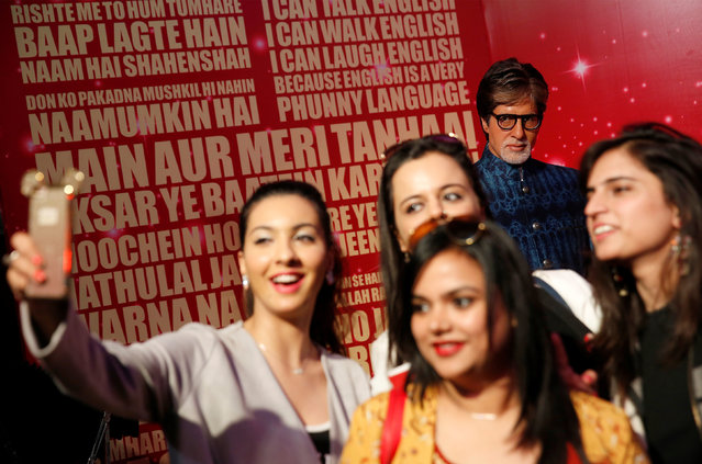 People take pictures of a waxwork of Bollywood actor Amitabh Bachchan at a photocall for the new Madam Tussaud's waxwork museum in New Delhi, India January 12, 2017. (Photo by Cathal McNaughton/Reuters)