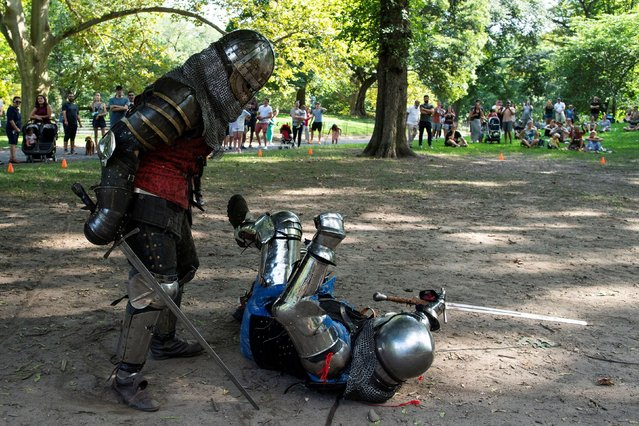 People in full medieval armor take part in a combat at Central Park in New York, U.S., August 14, 2021. (Photo by Eduardo Munoz/Reuters)