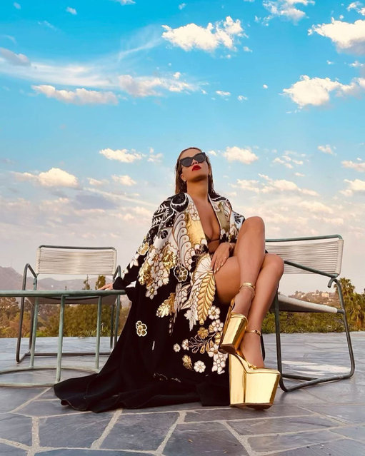 English singer Rita Ora looked like she was sitting on a gold mine as she reclined in towering, metallic shoes and an open gown during a photoshoot in Los Angeles on August 5, 2021. (Photo by Instagram)