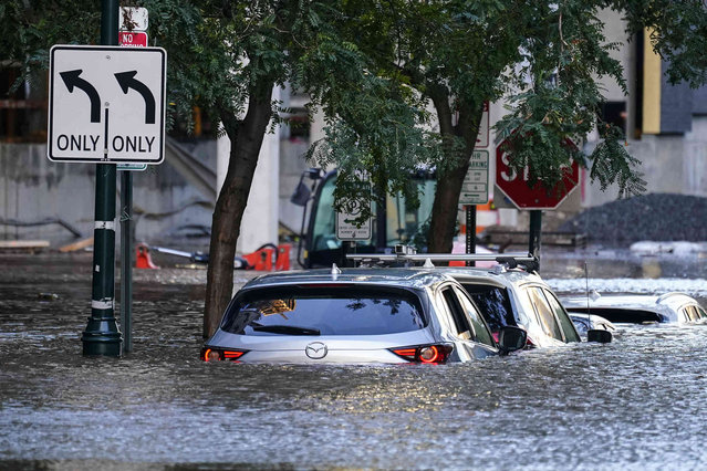 Vehicles are under water during flooding in Philadelphia, Thursday, September 2, 2021 in the aftermath of downpours and high winds from the remnants of Hurricane Ida that hit the area. (Photo by Matt Rourke/AP Photo)
