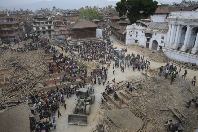 People search for survivors under the rubble of collapsed buildings in Kathmandu Durbar Square, after an earthquake caused serious damage in Kathmandu, Nepal, 25 April 2015. (Photo by Narendra Shrestha/EPA)