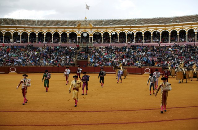 Spanish matadores, assistants and picadores walk before the start of a bullfight at The Maestranza bullring in the Andalusian capital of Seville, southern Spain April 26, 2015. (Photo by Marcelo del Pozo/Reuters)