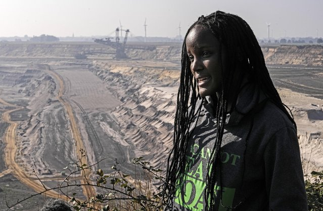 Climate activist Vanessa Nakate from Uganda gives an interview to the Associated Press during her visit to the Garzweiler open-cast coal mine in Luetzerath, western Germany, Saturday, October 9, 2021. Garzweiler, operated by utility giant RWE, has become a focus of protests by people who want Germany to stop extracting and burning coal as soon as possible. (Photo by Martin Meissner/AP Photo)