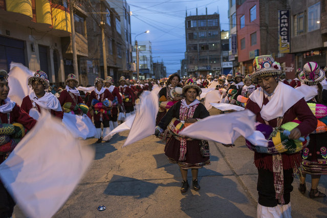 """In this January 29, 2017 photo, dancers perform during Virgin of Candelaria celebrations in downtown Puno, Peru. """"We have danced this way since the time of our grandparents"""", said 75 year-old Martin Mamani, who had made the trek from the village of Esmeralda. (Photo by Rodrigo Abd/AP Photo)"""