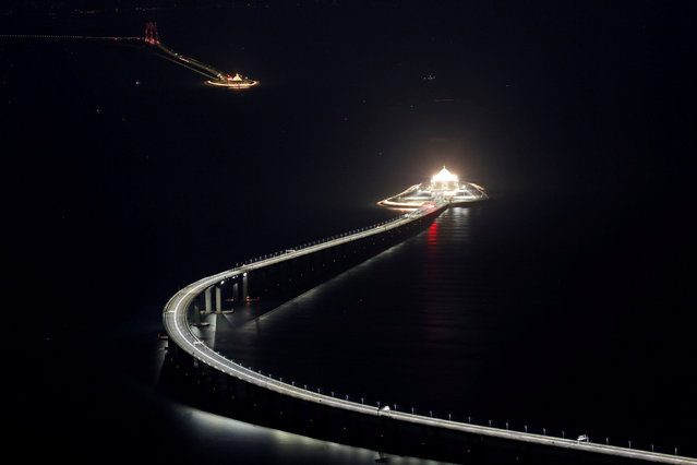An evening view of the Hong Kong-Zhuhai-Macau bridge and its entrances to a cross sea tunnel, off Lantau island in Hong Kong, China October 21, 2018, before its opening ceremony on October 23, 2018. (Photo by Bobby Yip/Reuters)