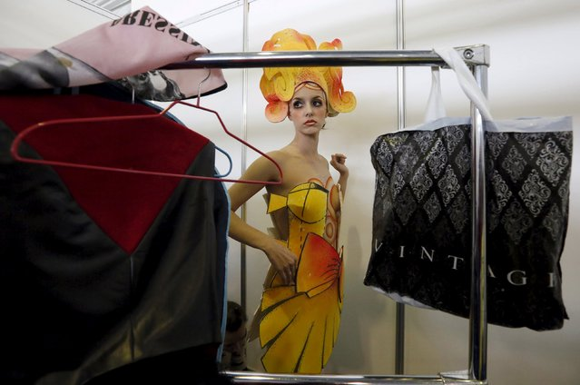"A model prepares backstage during the ""Ideal of Beauty"" festival and exhibition in Russia's Siberian city of Krasnoyarsk, April 25, 2015. (Photo by Ilya Naymushin/Reuters)"
