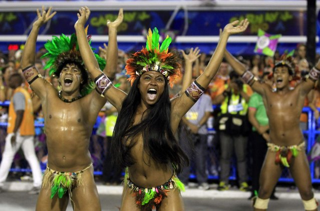 Revellers of the Mangueira samba school participate in the annual Carnival parade in Rio de Janeiro's Sambadrome, March 3, 2014. (Photo by Pilar Olivares/Reuters)